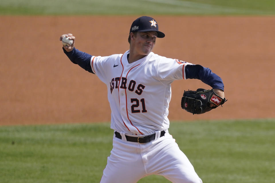 Houston Astros' Zack Greinke pitches against the Oakland Athletics during the first inning of Game 4 of a baseball American League Division Series in Los Angeles, Thursday, Oct. 8, 2020. (AP Photo/Ashley Landis)