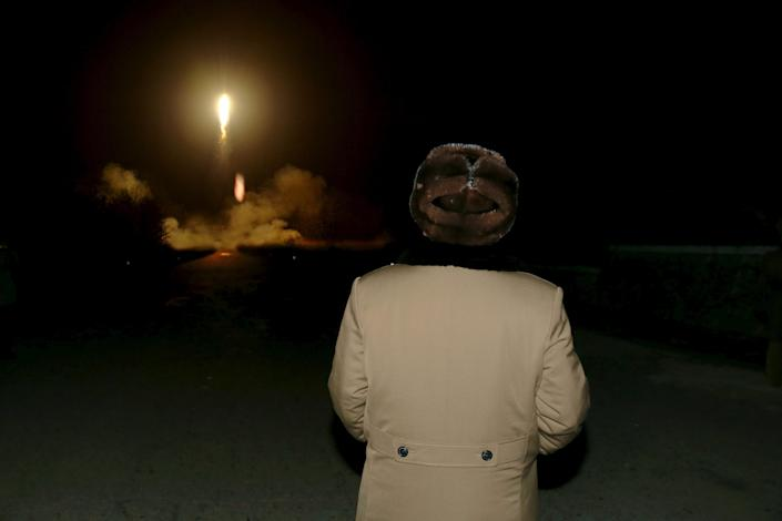 Kim Jong Un watches a ballistic rocket launch drill of the the Korean People's Army at an unknown location in 2016. (Photo: KCNA/Reuters)