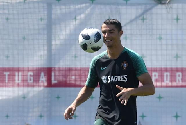 Cristiano Ronaldo doubled his number of World Cup goals with a hat-trick against Spain (AFP Photo/Francisco LEONG)