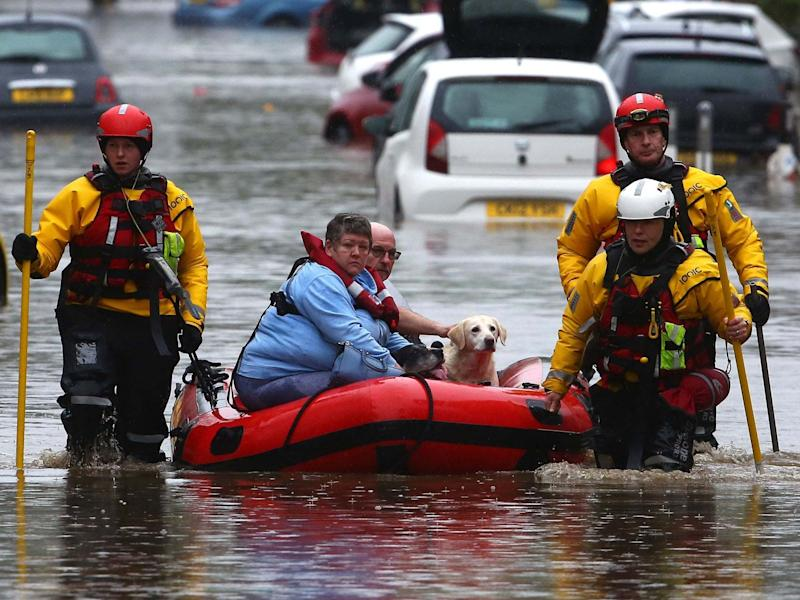 Residents and pets are evacuated from flooded homes in Nantgarw, South Wales: AFP via Getty