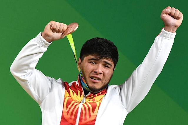 "Kyrgyzstan's <a class=""link rapid-noclick-resp"" href=""/olympics/rio-2016/a/1087397/"" data-ylk=""slk:Izzat Artykov"">Izzat Artykov</a> was stripped of his bronze weightlifting medal by the IOC. (Getty Images)"