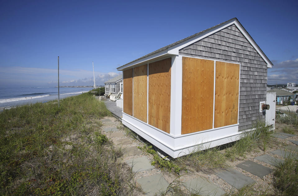 A beach house on East Matunuck beach in South Kingstown, R.I., is boarded up in preparation for Hurricane Henri Saturday, Aug. 21, 2021. New Englanders, bracing for their first direct hit by a hurricane in 30 years, are taking precautions as Tropical Storm Henri barrels toward the southern New England coast. (AP Photo/Stew Milne)