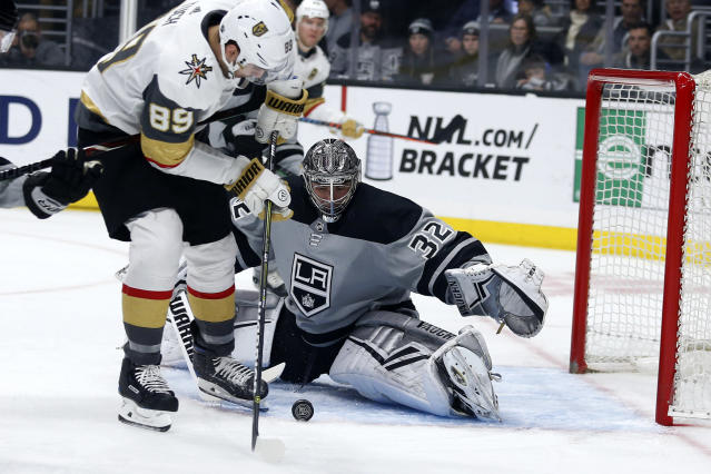 Los Angeles Kings goalie Jonathan Quick (32) stops a shot by Vegas Golden Knights forward Alex Tuch (89) during the first period of an NHL hockey game Saturday, April 6, 2019, in Los Angeles. (AP Photo/Ringo H.W. Chiu)