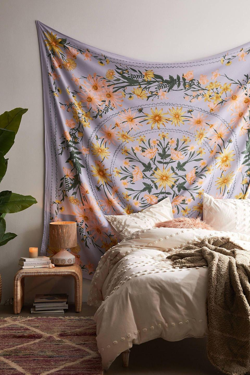 """<p><strong>Urban Outfitters</strong></p><p>urbanoutfitters.com</p><p><strong>$49.00</strong></p><p><a href=""""https://go.redirectingat.com?id=74968X1596630&url=https%3A%2F%2Fwww.urbanoutfitters.com%2Fshop%2Fclara-floral-tapestry&sref=https%3A%2F%2Fwww.cosmopolitan.com%2Flifestyle%2Fg31699444%2Fgemini-gift-guide%2F"""" rel=""""nofollow noopener"""" target=""""_blank"""" data-ylk=""""slk:Shop Now"""" class=""""link rapid-noclick-resp"""">Shop Now</a></p><p>Geminis love to sprinkle a bit of their unique identity into every piece of living space they can, and we are one hundred percent here for it. A brightly colored patterned tapestry will definitely add Gemini's outgoing personality to any room.</p>"""
