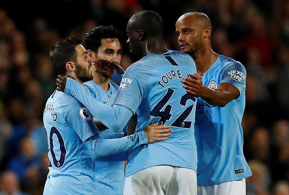 Soccer Football – Premier League – Manchester City v Brighton & Hove Albion – Etihad Stadium, Manchester, Britain – May 9, 2018 Manchester City's Yaya Toure speaks with Vincent Kompany (R), Ilkay Gundogan (2nd L) and Bernardo Silva (L) as he is substituted off. Action Images via Reuters/Jason Cairnduff