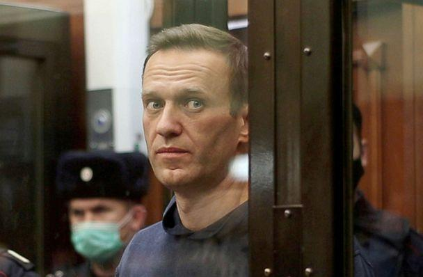 PHOTO: A still image taken from video footage shows Russian opposition leader Alexei Navalny inside a defendant dock during the announcement of a court verdict in Moscow, Feb. 2, 2021.  (Simonovsky District Court via Reuters, FILE)