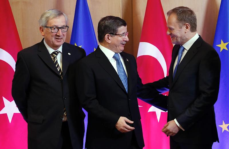 Turkish Prime Minister Ahmet Davutoglu (centre) congratulated himself on having driven a hard bargain with EU leaders during a migration summit in Brussels, on March 7, 2016 (AFP Photo/Francois Lenoir)
