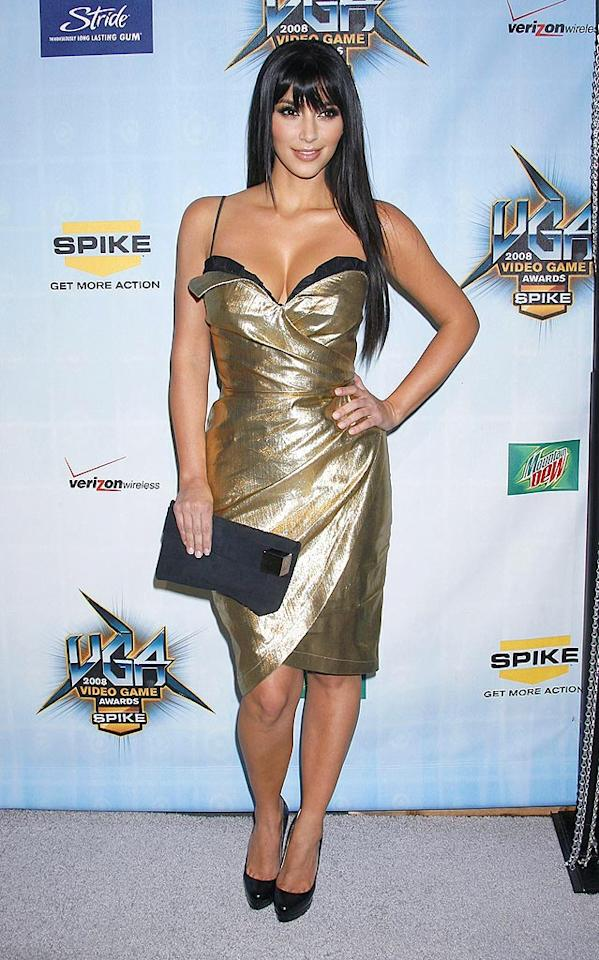 "Red carpet regular Kim Kardashian glittered in a gold gown. Jeffrey Mayer/<a href=""http://www.wireimage.com"" target=""new"">WireImage.com</a> - December 14, 2008"
