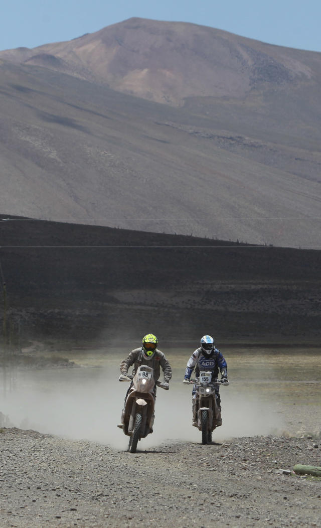 KTM rider Stephane Hamard of France, left, and Yamaha rider Sebastian Alberto Urquia of Argentina race during the eighth stage of the Dakar Rally between the cities Uyuni, Bolivia and Calama, Chile in Kui, Bolivia, Monday, Jan. 13, 2014. (AP Photo/Juan Karita)