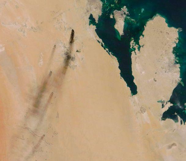 PHOTO: This Sept. 14, 2019, satellite image provided by NASA Worldview shows fires following Yemen's Houthi rebels claiming a drone attack on two major oil installations in eastern Saudi Arabia. (NASA Worldview via AP)