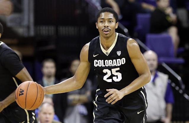 Colorado's Spencer Dinwiddie in action against Washington in the first half of an NCAA men's basketball game Sunday, Jan. 12, 2014, in Seattle. (AP Photo/Elaine Thompson)