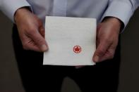 CEO Dan Goldberg holds a napkin at the offices of Telesat in Ottawa
