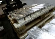 FILE PHOTO: Bars of silver are placed on wooden pallets at the KGHM copper and precious metals smelter processing plant in Glogow