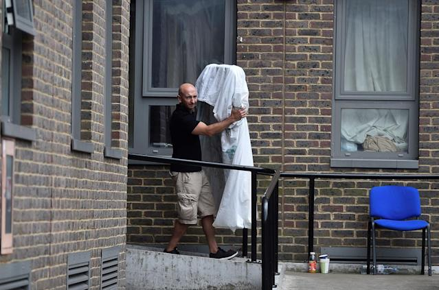 <p>A man carries a mattress from the Dorney Tower residential block, as residents were evacuated as a precautionary measure following concerns over the type of cladding used on the outside of the buildings on the Chalcots Estate in north London, Britain, June 25, 2017. (Photo: Hannah McKay/Reuters) </p>
