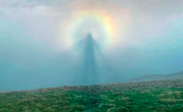 The rare weather phenomenon that appears to show a ghostly 'angel in the sky' at the centre of a rainbow-like halo (SWNS)