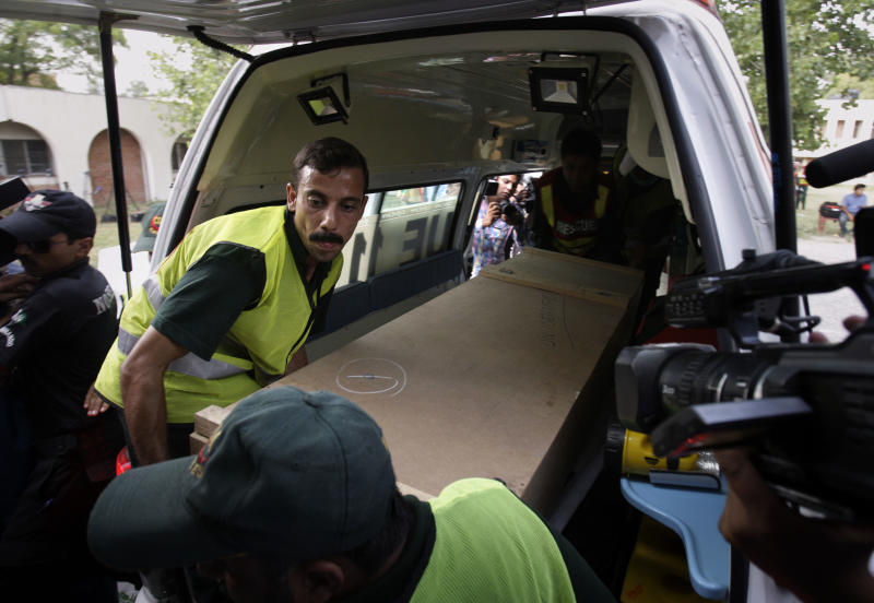 Pakistani rescue workers unload the casket of a foreign tourist who was killed by Islamic militants from an ambulance to shift in a morgue of local hospital in Islamabad, Pakistan, Sunday, June 23, 2013. Islamic militants wearing police uniforms shot to death foreign tourists and at least one Pakistani before dawn as they were visiting one of the world's highest mountains in a remote area of northern Pakistan that has been largely peaceful, officials said. (AP Photo/Anjum Naveed)