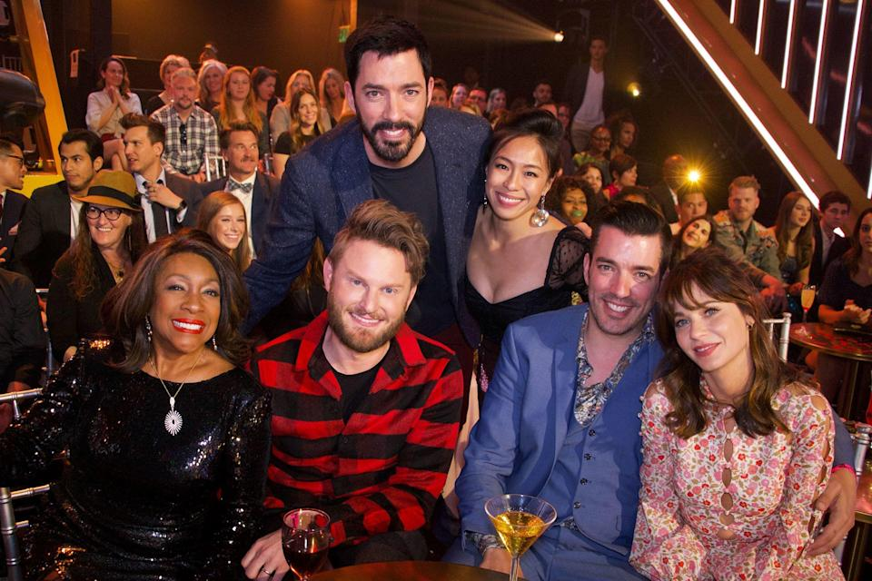 """The couple was <a href=""""https://people.com/home/jonathan-scott-zooey-deschanel-kiss-front-row-dancing-with-the-stars/"""" rel=""""nofollow noopener"""" target=""""_blank"""" data-ylk=""""slk:spotted smooching"""" class=""""link rapid-noclick-resp"""">spotted smooching</a> while front row at a taping of <em>Dancing with the Stars </em>on Sept. 30. """"He makes her laugh and he's so sweet to her,"""" a source <a href=""""https://people.com/home/zooey-deschanel-and-jonathan-scott-are-instagram-official/"""" rel=""""nofollow noopener"""" target=""""_blank"""" data-ylk=""""slk:told PEOPLE."""" class=""""link rapid-noclick-resp"""">told PEOPLE.</a> """"They bonded over a shared love of music. He's very close to his family and loves children."""""""