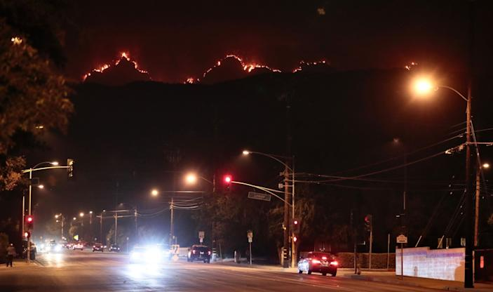 "The Bobcat Fire smolders in the mountains above Monrovia on Thursday evening. <span class=""copyright"">(Robert Gauthier/Los Angeles Time)</span>"