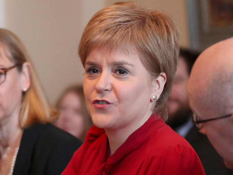 Nicola Sturgeon has been criticised by Conservatives who say she has devolved powers to contest the new measures: Reuters