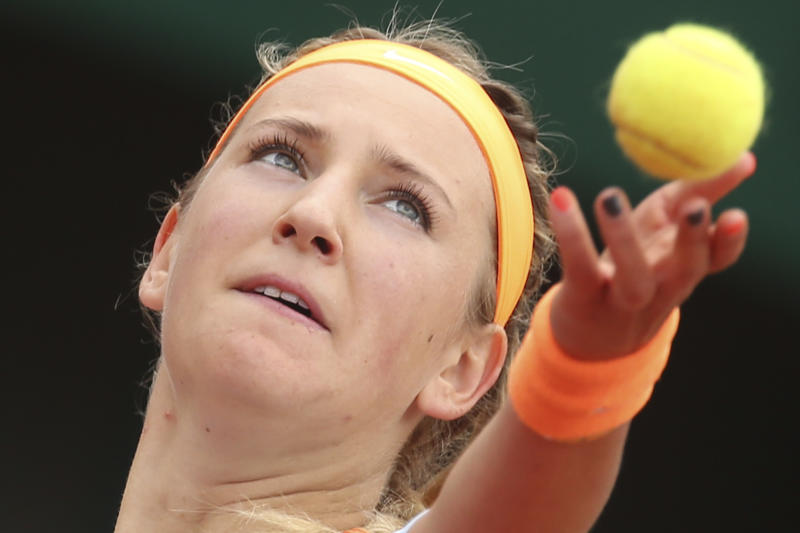 Victoria Azarenka of Belarus serves against Italy's Francesca Schiavone in their fourth round match at the French Open tennis tournament, at Roland Garros stadium in Paris, Monday June 3, 2013. (AP Photo/Michel Euler)