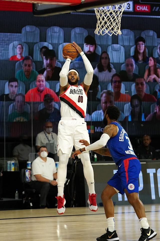 <p>Carmelo Anthony of the Portland Trail Blazers goes for a jump shot during a game against the Los Angeles Clippers on Saturday in Orlando, Florida.</p>