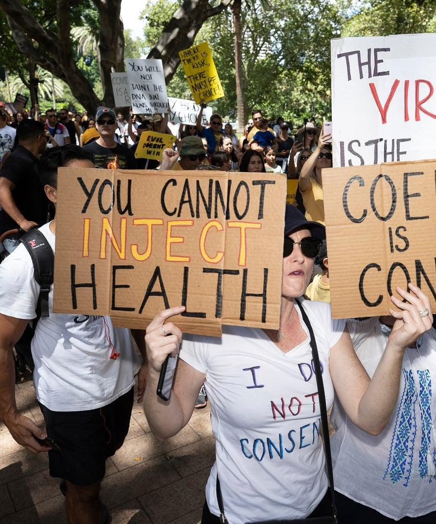 SYDNEY, AUSTRALIA – FEBRUARY 20: Protestors are seen at an anti-vaccination rally in Sydney on February 20, 2021 in Sydney, Australia. The protestors, who numbered in the hundreds, are demonstrating against mandatory COVID-19 vaccines. The rally began at Hyde Park, before a short march through the CBD. The COVID-19 vaccine is due to be rolled out to frontline health workers across Australia from next week. The Australian government has purchased enough vaccines for all Australians to be vaccinated, should they choose to do so. While vaccinations are not mandatory, some industries might require workers to get the COVID-19 vaccine as a condition of employment. (Photo by Brook Mitchell/Getty Images)
