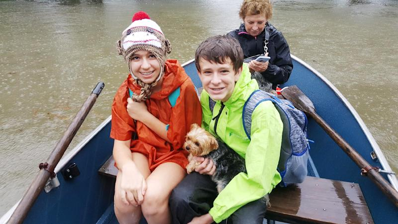 Bobbie, Gracie and Nolen Shumaker boated to safety Monday with their dog Coco in tow. (David Lohr/HuffPost)