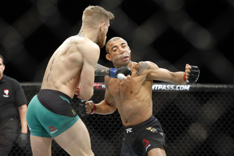 In this Dec. 12, 2015, file photo, Conor McGregor knocks out Jose Aldo during a featherweight championship bout at UFC 194 in Las Vegas. (AP Photo)