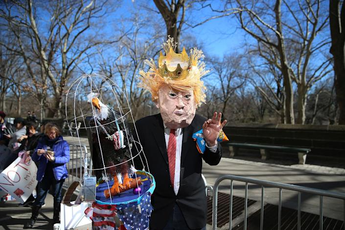 """<p>A demonstrator dressed as Donald Trump poses for photos before the """"Not My President's Day"""" rally at Central Park West in New York City on Feb. 20, 2017. (Gordon Donovan/Yahoo News) </p>"""