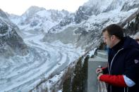 FILE PHOTO: French president Emmanuel Macron looks at the Mer de glace glacier from the Montenvers railway station near Chamonix, at the Mont Blanc mountain range in the French Alps