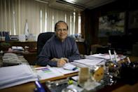 Bangladesh's central bank governor Atiur Rahman poses inside his office in Dhaka in this October 2, 2013 file photo. REUTERS/Andrew Biraj/Files