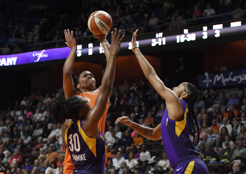 Connecticut Sun's Alyssa Thomas, center, shoots over Los Angeles Sparks' Nneka Ogwumike, left, and Los Angeles Sparks' Candace Parker right, during the first half of a WNBA basketball playoff game, Tuesday, Sept. 17, 2019, in Uncasville, Conn. (AP Photo/Jessica Hill)