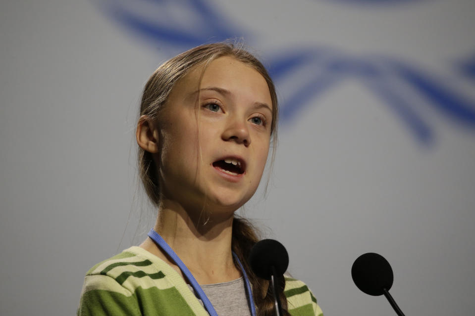 Swedish climate activist Greta Thunberg addresses plenary of U.N. climate conference during with a meeting with leading climate scientists at the COP25 summit in Madrid, Spain, Wednesday, Dec. 11, 2019. Thunberg is in Madrid where a global U.N.-sponsored climate change conference is taking place. (AP Photo/Paul White)
