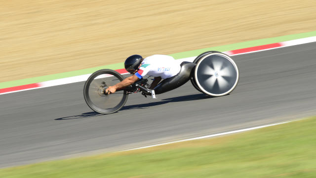Italy's Alessandro Zanardi heads towards victory in the men's individual H4 time trial cycling finals during the London 2012 Paralympic Games at Brands Hatch circuit, in Kent, southern England on September 5, 2012. AFP PHOTO / LEON NEALLEON NEAL/AFP/GettyImages