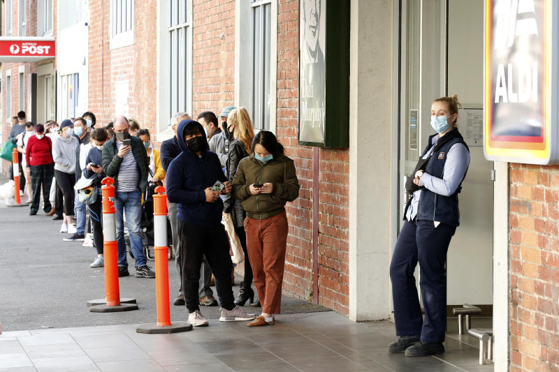MELBOURNE, AUSTRALIA - AUGUST 02: Large crowds of people are seen standing in line to enter a supermarket in South Melbourne on August 02, 2020 in Melbourne, Australia. Public concern has increased as speculation grows that Premier Daniel Andrews will introduce further restrictions in his daily briefing (Photo by Darrian Traynor/Getty Images)