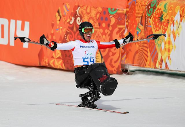 SOCHI, RUSSIA - MARCH 08: Josh Dueck of Canada celebrates at the finish of the Men's Downhill Sitting during day one of Sochi 2014 Paralympic Winter Games at Rosa Khutor Alpine Center on March 8, 2014 in Sochi, Russia. (Photo by Ian Walton/Getty Images)