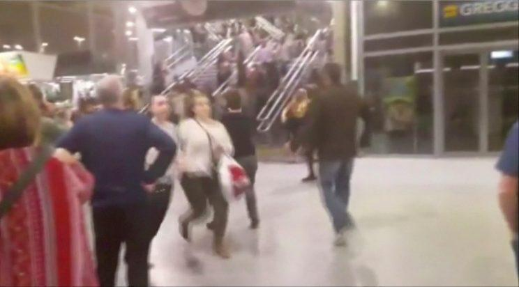 Images and video from inside the building showing concert goers fleeing for their lives