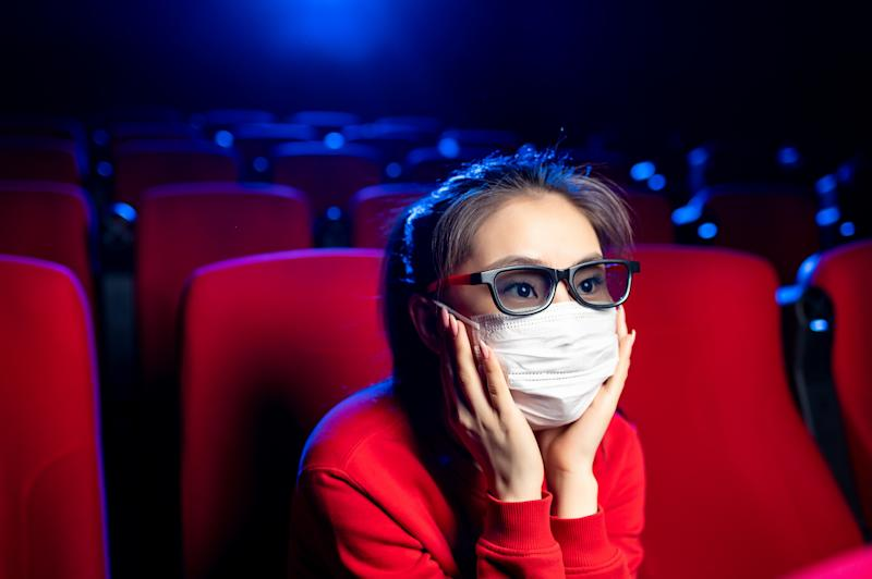 sick person cinema mask watch movie public virus asian epidemic