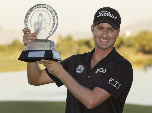 Webb Simpson holds up the championship trophy after winning in the final round of the STPC Summerlin tournament, Sunday, Oct. 20, 2013, in Las Vegas. Simpson won the tournament finishing 24-under 260. (AP Photo/Julie Jacobson)