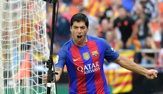 Barcelona's Uruguayan forward Luis Suarez celebrates after scoring during the Spanish league football match Valencia CF vs FC Barcelona at the Mestalla stadium in Valencia on October 22, 2016