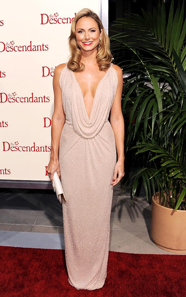 "Stacy Keibler's neckline took a major dip at the Los Angeles premiere of ""The Descendants."" Think her boyfriend George Clooney approved of her sexy Naeem Khan frock?<span style=""font-style:italic;""> </span><em></em>(11/15/2011)"