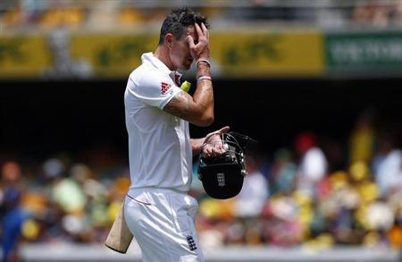 England's Kevin Pietersen reacts as he walks off the field after his dismissal during the fourth day's play of their first Ashes cricket test match against Australia in Brisbane November 24, 2013. REUTERS/David Gray