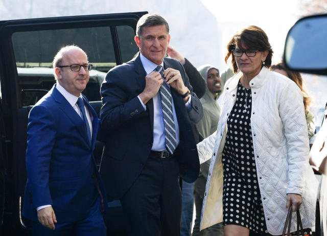 Former Trump national security adviser Michael Flynn, center, arrives at federal court in Washington, D.C., on Dec. 1.  (Photo: Susan Walsh/AP)
