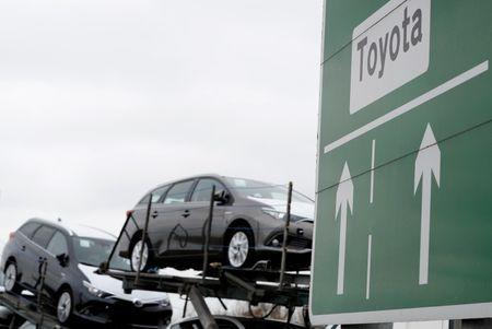 FILE PHOTO: New Toyota cars are transported from their manufacturing facility in Burnaston, Britain March 16, 2017. REUTERS/Darren Staples