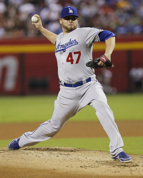 Los Angeles Dodgers pitcher Ricky Nolasco delivers a pitch against the Arizona Diamondbacks during the first inning of a baseball game, Tuesday, July 9, 2013, in Phoenix. (AP Photo/Matt York)