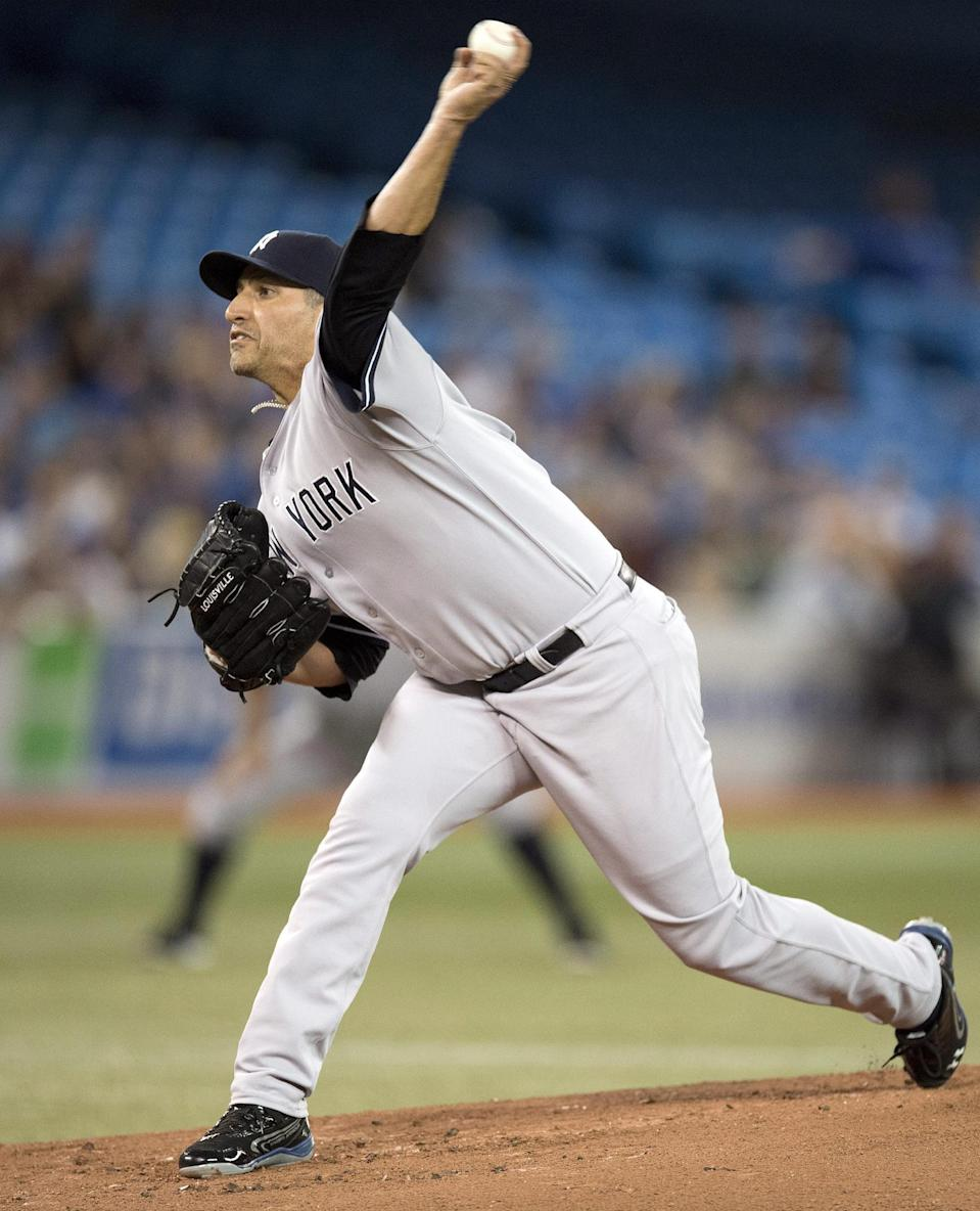 New York Yankees starter Andy Pettitte pitches against the Toronto Blue Jays during the first inning of a baseball in Toronto on Tuesday, Aug. 27, 2013. (AP Photo/The Canadian Press, Frank Gunn)