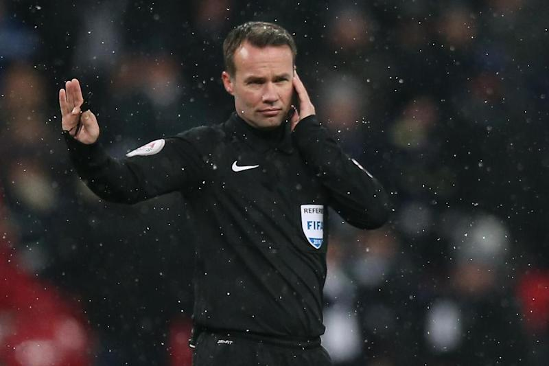 Ear we go: Referee Paul Tierney listens to the VAR during Wednesday's Cup clash at Wembley: Tottenham Hotspur FC via Getty Images