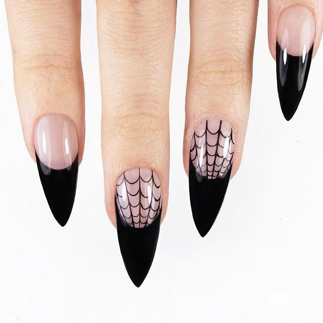 """<p>Natural nails with black tips and a spider web embellishment a subtle nod to Halloween. Use a tiny brush to draw in the web design.</p><p><a class=""""link rapid-noclick-resp"""" href=""""https://www.amazon.com/Beautifultracy-Brushes-Dual-ended-Painting-Acrylic/dp/B0834BFYBX/?tag=syn-yahoo-20&ascsubtag=%5Bartid%7C10050.g.33512580%5Bsrc%7Cyahoo-us"""" rel=""""nofollow noopener"""" target=""""_blank"""" data-ylk=""""slk:SHOP NAIL ART BRUSHES"""">SHOP NAIL ART BRUSHES</a></p><p><a href=""""https://www.instagram.com/p/BpIqowPhlmr/?utm_source=ig_embed&utm_campaign=loading"""" rel=""""nofollow noopener"""" target=""""_blank"""" data-ylk=""""slk:See the original post on Instagram"""" class=""""link rapid-noclick-resp"""">See the original post on Instagram</a></p>"""