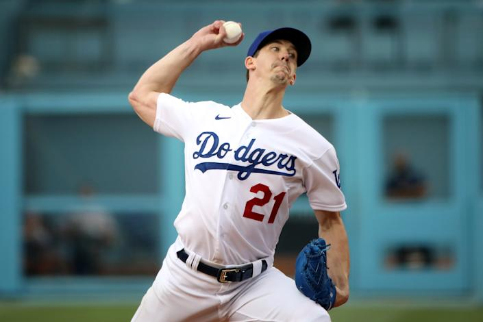 LOS ANGELES, CALIFORNIA - JULY 22: Walker Buehler #21 of the Los Angeles Dodgers pitches in the first inning against the San Francisco Giants at Dodger Stadium on July 22, 2021 in Los Angeles, California. (Photo by Katelyn Mulcahy/Getty Images)