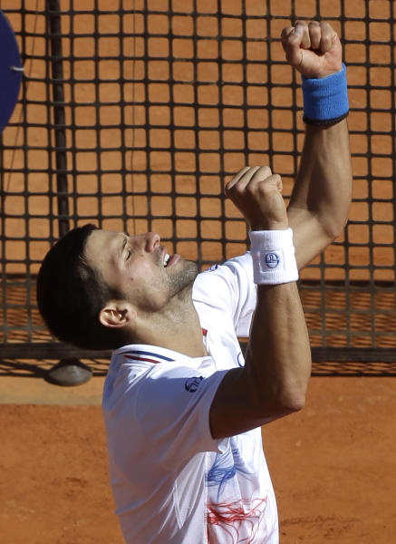Novak Djokovic of Serbia reacts after defeating Tomas Berdych of Czech Republic during their semifinal match of the Monte Carlo Tennis Masters tournament in Monaco, Saturday, April 21, 2012. (AP Photo/Lionel Cironneau)